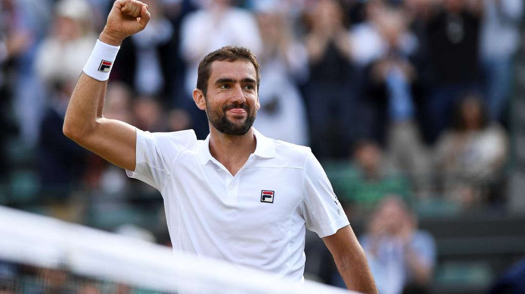Croatia's Marin                         Cilic celebrates winning the quarter-final match                         against Luxembourg's Gilles Muller.